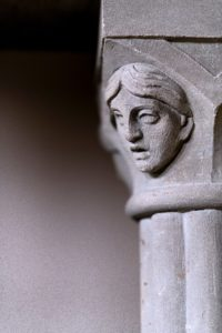 Carved human face showing anxiety. Psychotherapy